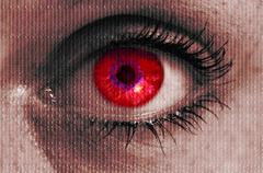 futuristic red eye with matrix texture looking at viewer - stock photo