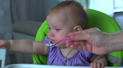 Baby refuses to eat. Dad feeding the baby girl Stock Footage