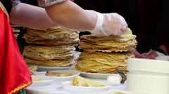 A large stack of pancakes at the fair for people to distribute holiday Maslen. Stock Footage