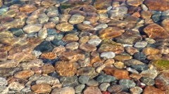 the colored stones in the water - stock footage