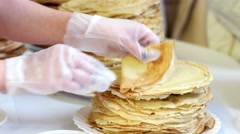 Distribution of pancakes stack of delicious pancakes fried food on holiday. Stock Footage