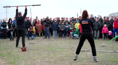 Sporting competitions power between men and women raising of sports. Stock Footage