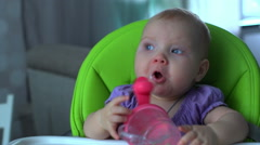 Baby drinking from bottle - stock footage