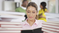 4K Portrait of smiling mature student studying with piles of books Stock Footage