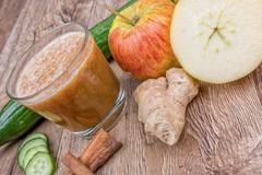 Blended smoothie with ingredients on wooden table - stock photo