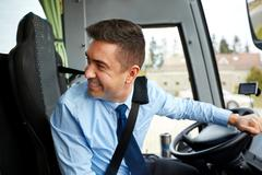Happy driver driving intercity bus Stock Photos