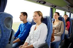 Group of happy passengers in travel bus Stock Photos