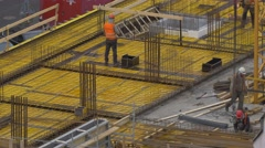 Men working at construction site - no color grading - stock footage