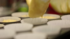 Close up of batter being poured into muffin tray - stock footage