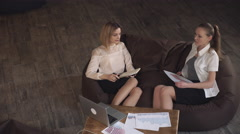Two women on the business meeting discussing financial report Stock Footage