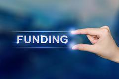 Hand clicking funding button Stock Photos