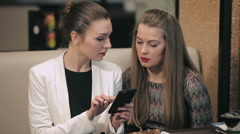 Two young businesswomen meet in restaurant - stock footage