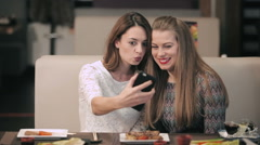 Two girls fooling around while doing selfie Stock Footage