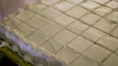Vanilla Cake Cut In Squares Stock Footage