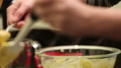Close up of woman scooping batter in muffin tray - stock footage