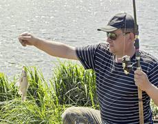 The fisherman caught the carp - stock photo