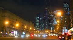Moscow street traffic and 'Moscow city' business district skyscrapers at night Stock Footage