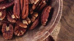 Portion of rotating Pecan Nuts (seamless loopable) Stock Footage