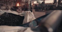 Close up bag of coals in blacksmith's workshop - stock footage