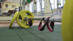 Closeup Barbell, Athlete Puts the Barbell Plates to the Bar Stock Footage