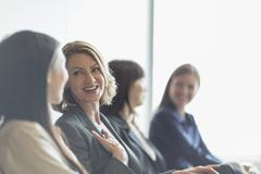 Smiling businesswomen talking - stock photo