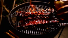 marinating spare ribs meat on barbeque food - stock footage