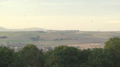 Aerostats (balloons) above the field and village Stock Footage