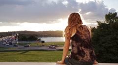 Teen Girl watching sunset from Jefferson Memorial Stock Footage