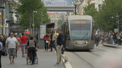 Tram stopped in a station on Avenue Jean Médecin in Nice Stock Footage