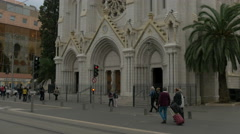 Tilt up of Basilique Notre-Dame de Nice on a cloudy afternoon in Nice Stock Footage