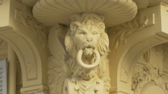 Architectural detail of a lion's head on a building in Nice Stock Footage