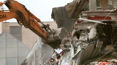 Bulldozer demolishes building Stock Footage