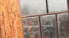 An old wardrobe in the garden getting wet in the rain. Stock Footage