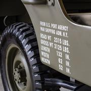 Dimensions and weights printed on the side of a military off road. - stock photo