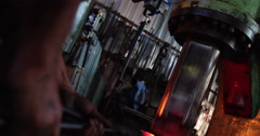 Hammering and forging the iron in blacksmith shop Stock Footage
