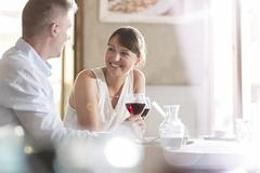Stock Photo of Couple drinking wine and talking at cafe
