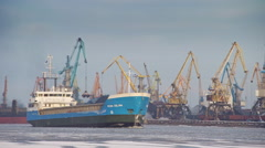 Stock Video Footage of Bulk carrier entering port of Riga during winter