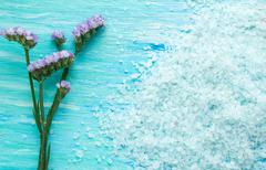 Sea salt with flowers on a blue wooden table Stock Photos