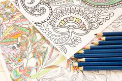 Adult colouring books pencils, new stress relieving trend, mindfulness concep - stock photo