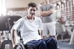 Portrait man in wheelchair at physical therapy Stock Photos