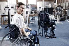 Man in wheelchair waiting for physical therapy Stock Photos