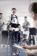 Smiling man with forearm crutches in physical therapy Kuvituskuvat
