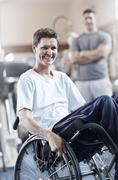 Portrait smiling man in wheelchair at physical therapy office Kuvituskuvat