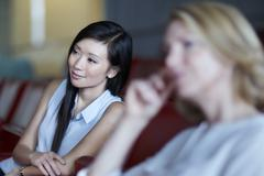 Businesswomen listening in meeting - stock photo