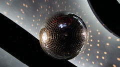 Disco ball spinning from the ceiling of a night club - stock footage