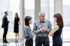 Stock Photo of Business people talking in lobby