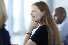 Confident businesswoman listening in meeting Stock Photos