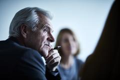 Attentive senior businessman listening in meeting Stock Photos