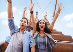 Portrait enthusiastic friends cheering on amusement park ride Kuvituskuvat