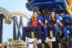 Young couple riding amusement park ride Stock Photos